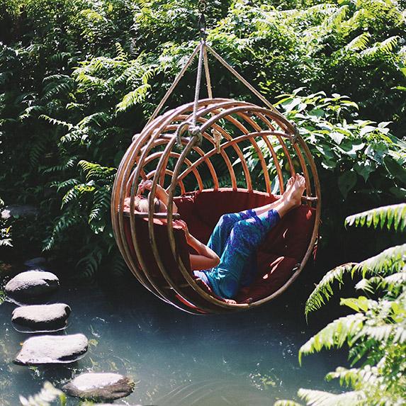 woman in a hammock in wilderness