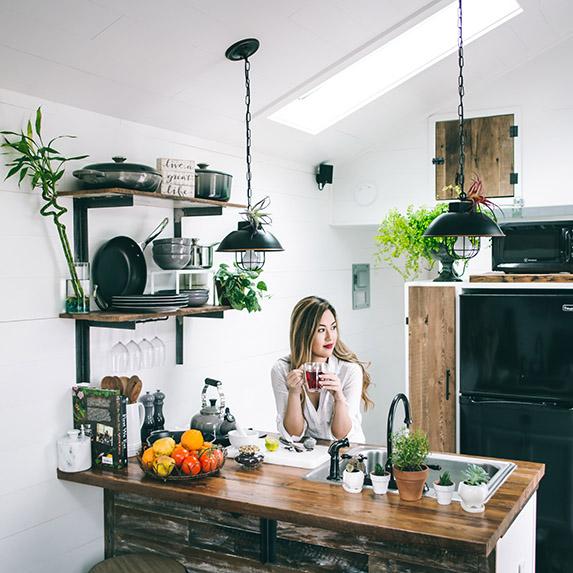 woman sitting at kitchen island drinking coffee
