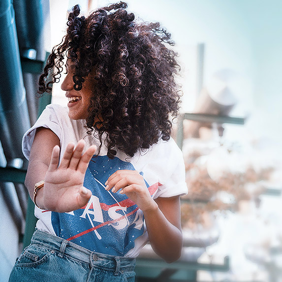 woman with curly hair laughing playfully
