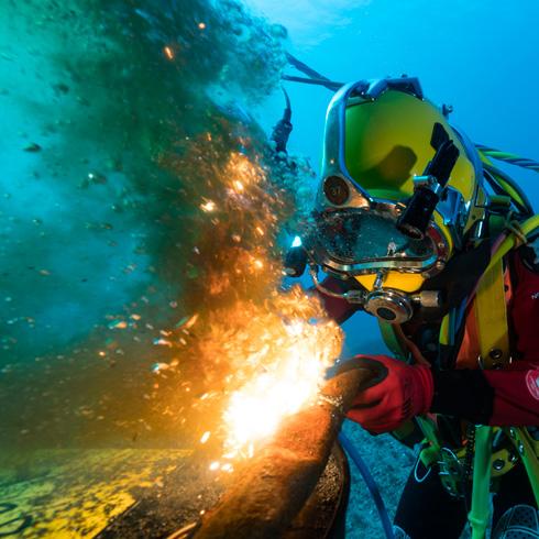 Underwater welder at work