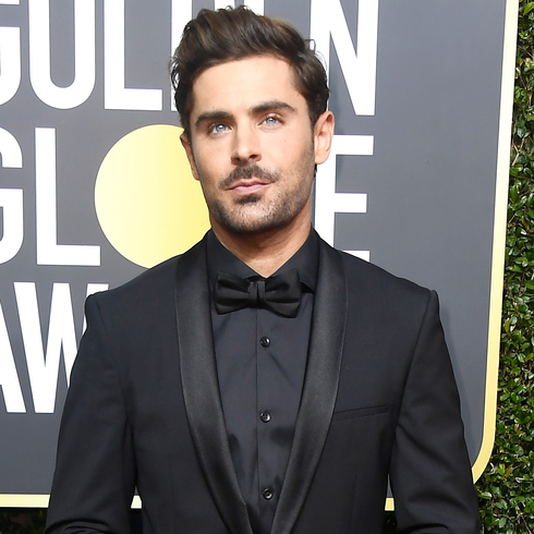 Zac Efron posing on the red carpet for 75th Annual Golden Globe Awards