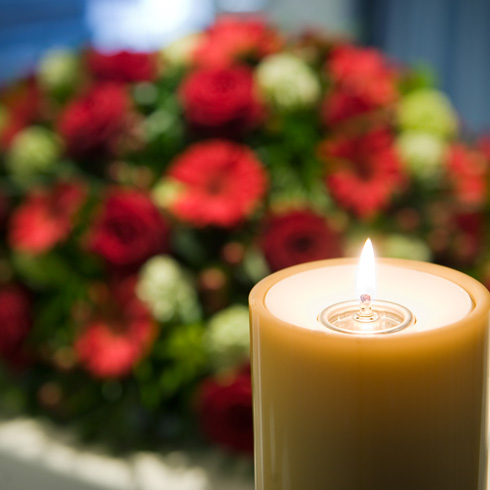 Candle and flowers in a funeral home