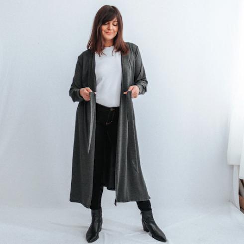 Long grey cardigan jacket on woman standing