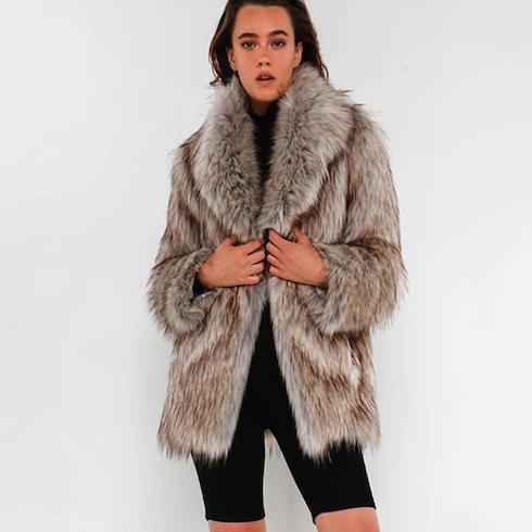 Woman wearing grey brown faux fur jacket