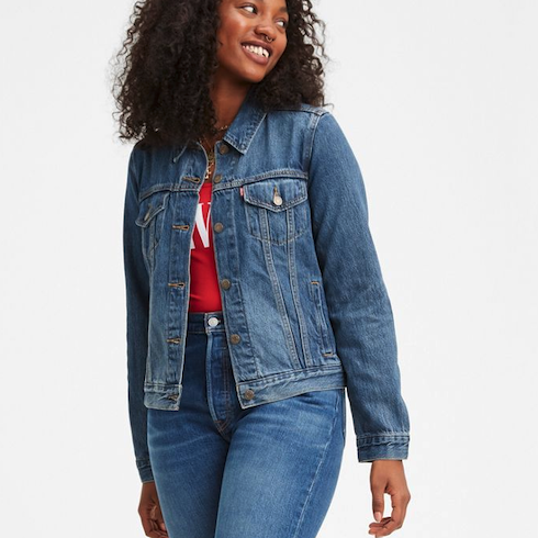 Blue denim jean jacket on woman looking over her shoulder