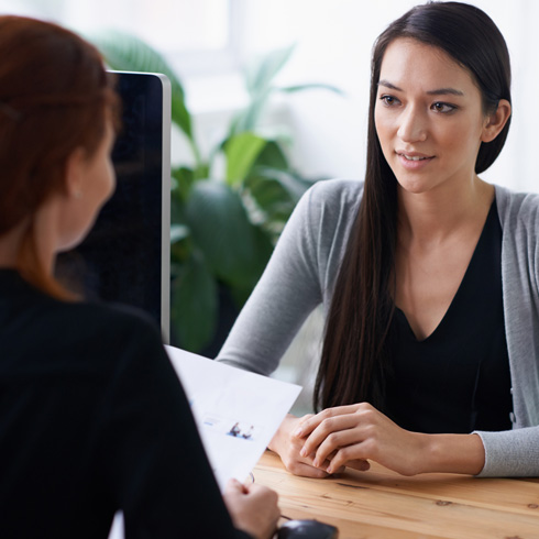 Human resources manager interviewing a candidate in their office
