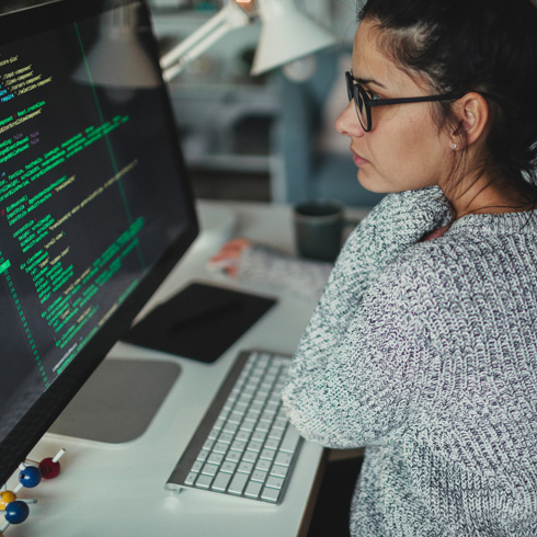 Software engineer looking at code on her screen