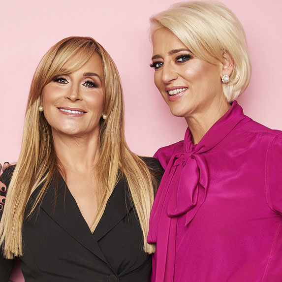 Sonja Morgan and Dorinda Medley pose next to each other against a pink background.