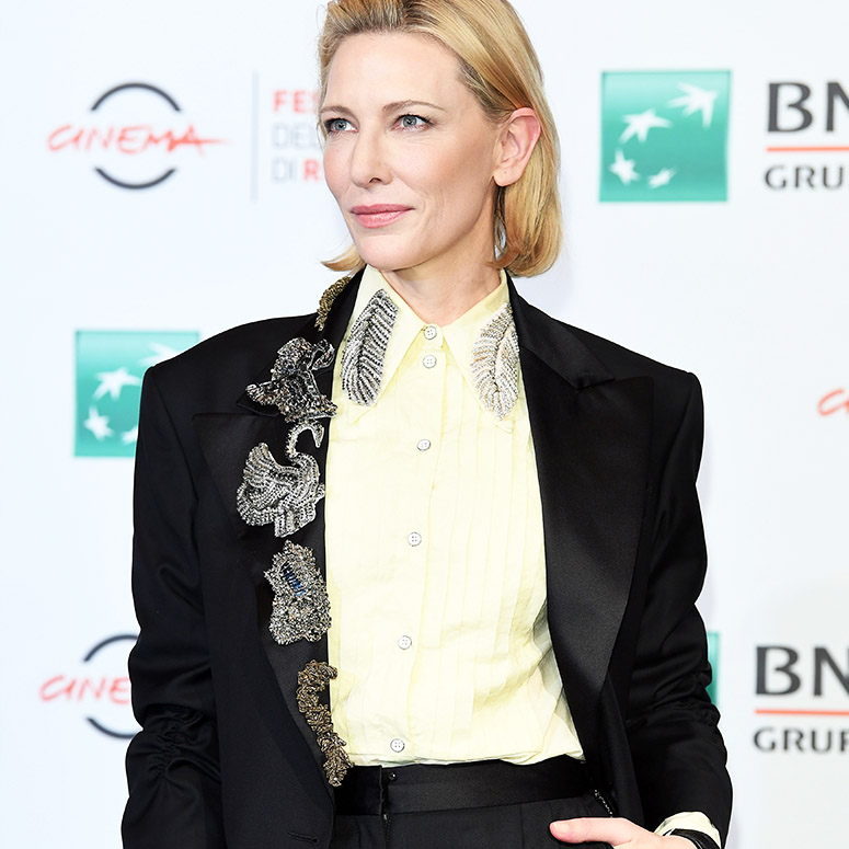Cate Blanchett wearing a suit and doing androgynous style right