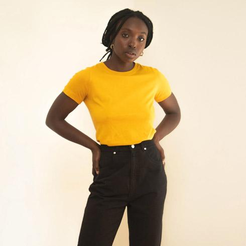 Woman modeling a yellow t-shirt