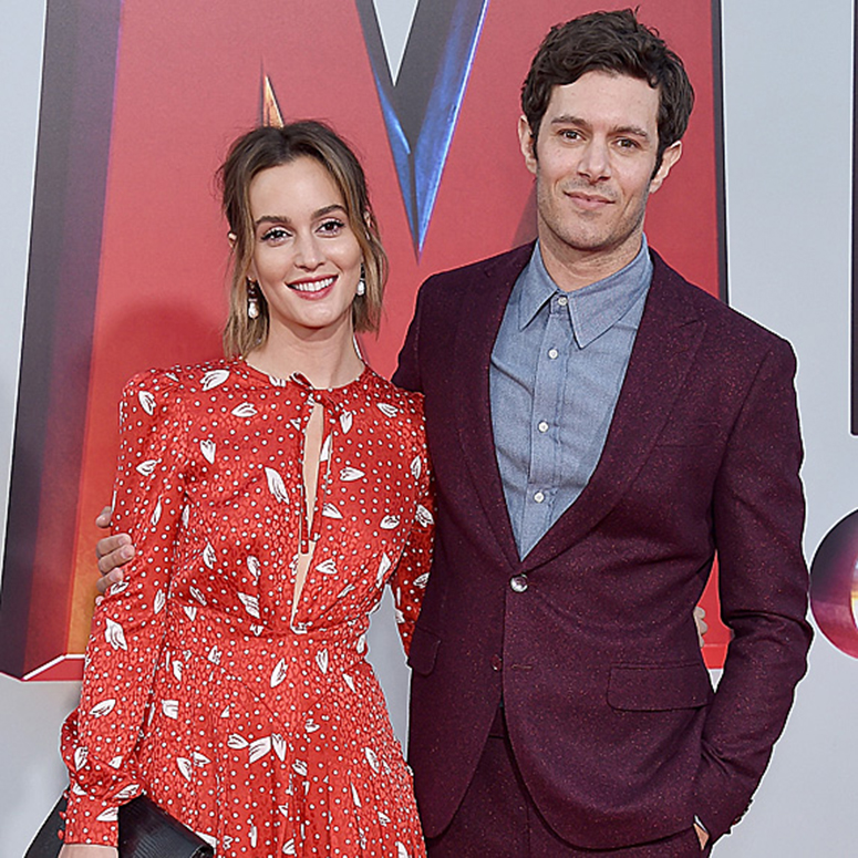 Leighton Meester and Adam Brody posing at an event