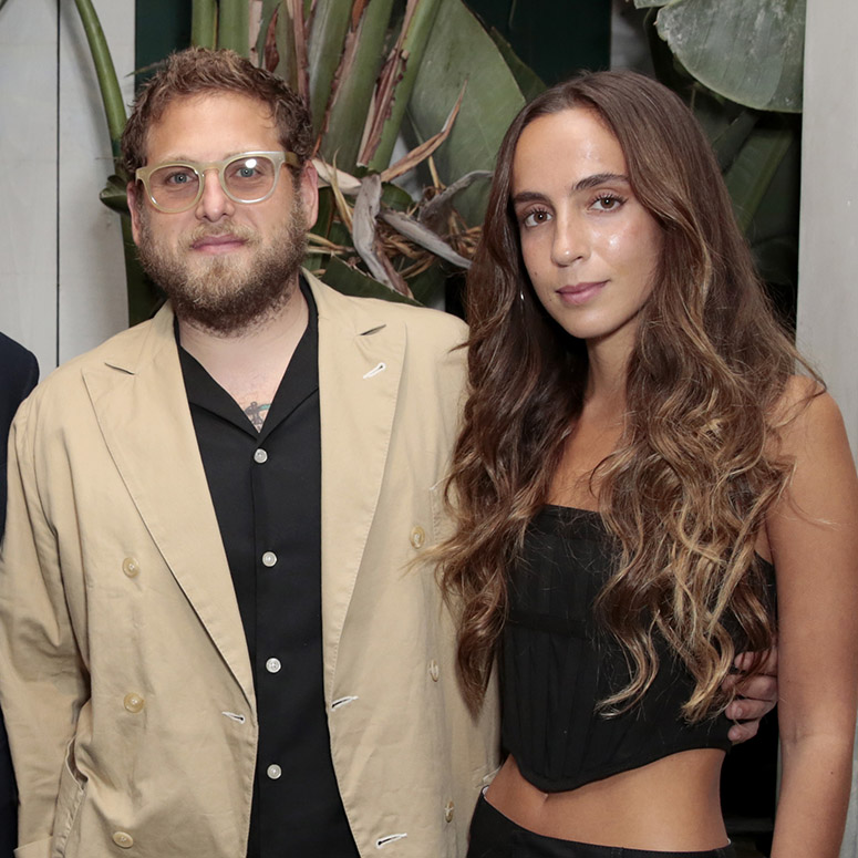 Jonah Hill and Gianna Santos pose at an event