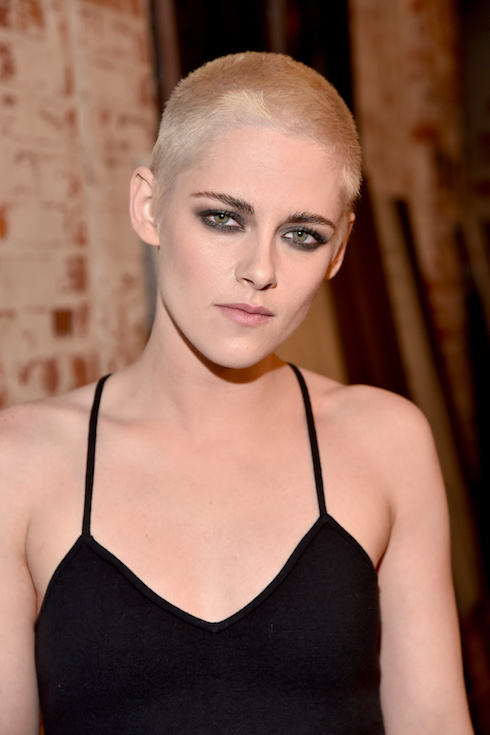 Kristen Stewart wears her hair in a shaved, blonde hairstyle