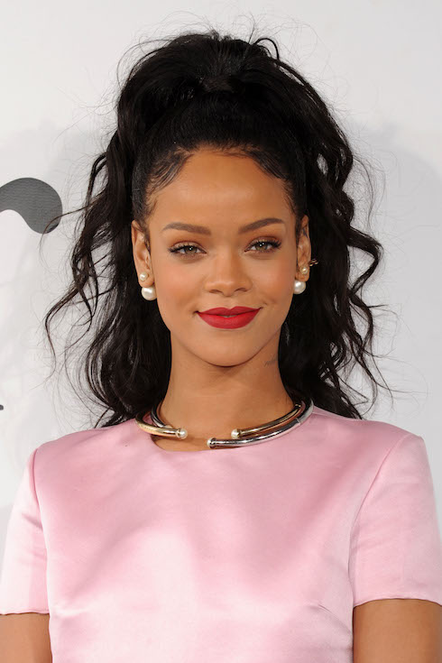 Rihanna wears her hair in a dark brown hairstyle