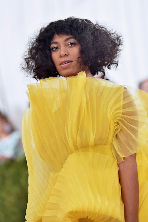 Solange Knowles wears her hair in a brunette style