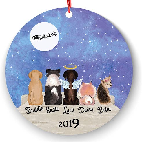A Christmas ornament with dogs on it