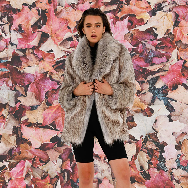 Woman modeling faux fur jacket