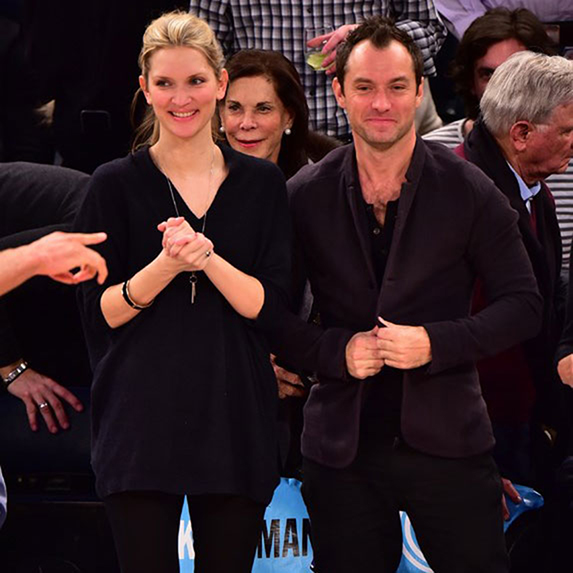 Jude Law and Phillipa Coan standing at an event