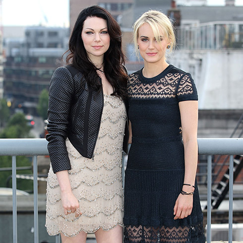 Laura Prepon and Taylr Schilling taking photos to promote Orange is the New Black