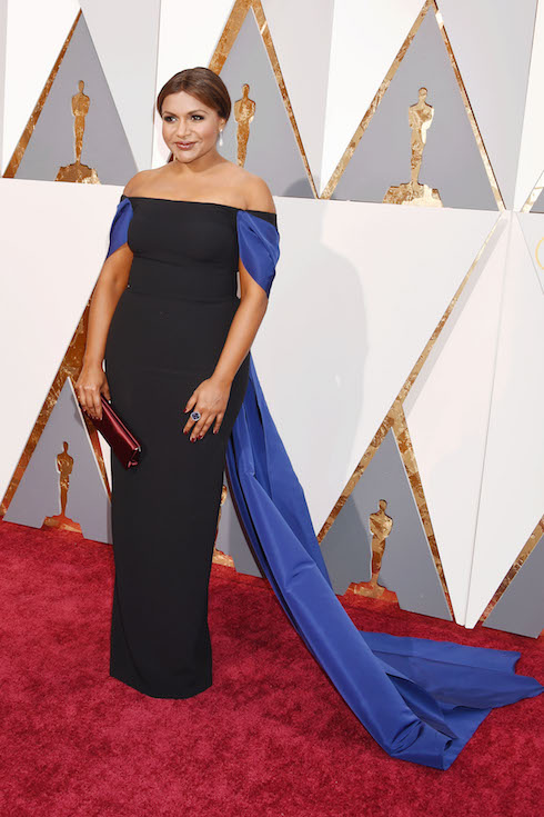 Mindy Kaling wears a black off-the-shoulder gown with blue details fort he 2016 Academy Awards
