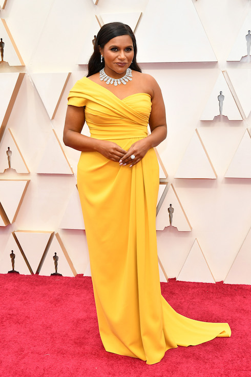 Mindy Kaling wears a bold yellow one-shoulder gown on the red carpet for the 2020 Academy Awards