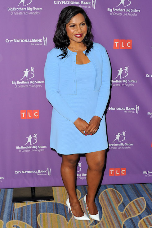 Mindy Kaling wears a baby blue cardigan and dress set to an event in 2017