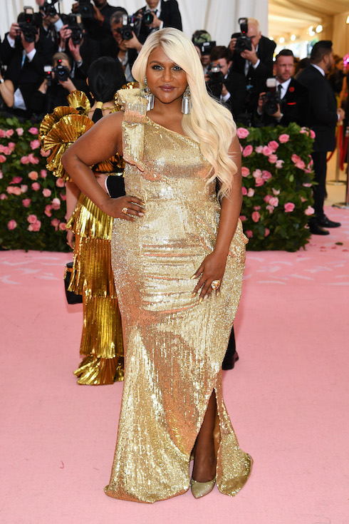 Mindy Kaling wears a gold gown and platinum-blonde wig for the 2019 MET Gala