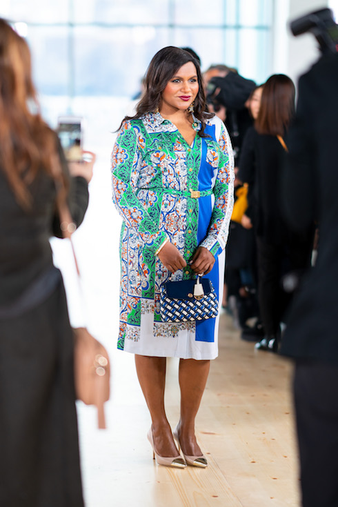 Mindy Kaling wears a print dress to a Tory Burch fashion show in 2019