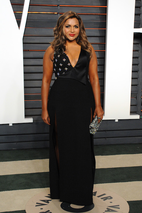 Mindy Kaling wears a low-cut black gown to the 2016 Vanity Fair Oscar Party