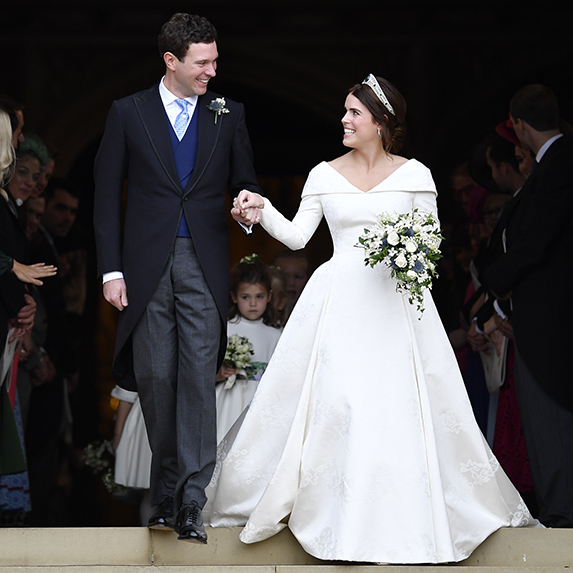 Jack Brooksbank and Princess Eugenie of York leave the wedding of Princess Eugenie of York to Jack Brooksbank at St. George's Chapel on October 12, 2018 in Windsor, England.