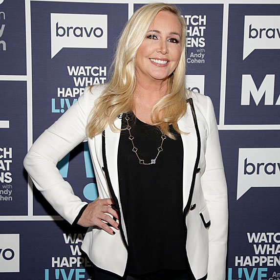 Shannon Beador poses on a red carpet at a Bravo event.