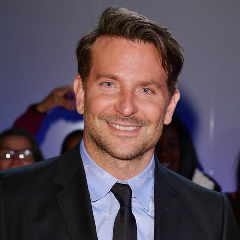A close up of Bradley Cooper in suit and tie on the red carpet