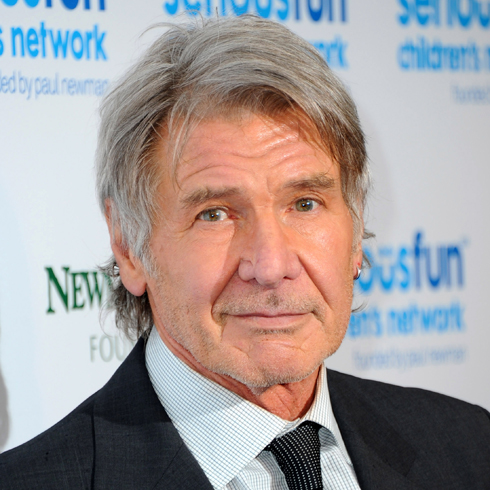 Harrison Ford in a suit and tie at a red carpet event