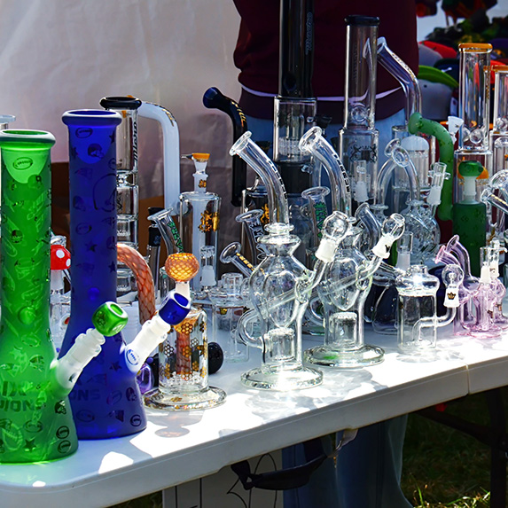Display table with different kinds of bongs on it