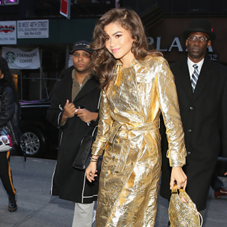 Actress/singer, Zendaya, seen in New York City, wearing a gold trench coat.