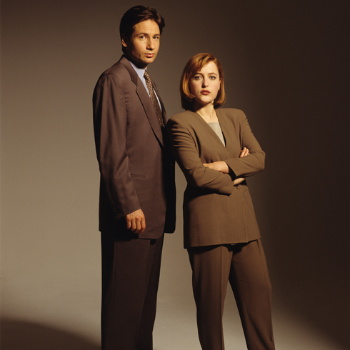 David Duchovny and Gillian Anderson as Mulder and Scully in a 1990s photo shoot