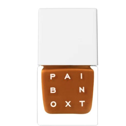 bottle of muted orange nail polish