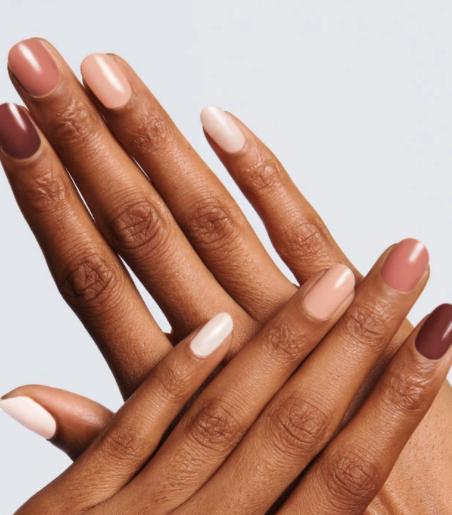 fall nail polish colours, brown, cream, nude on human hands