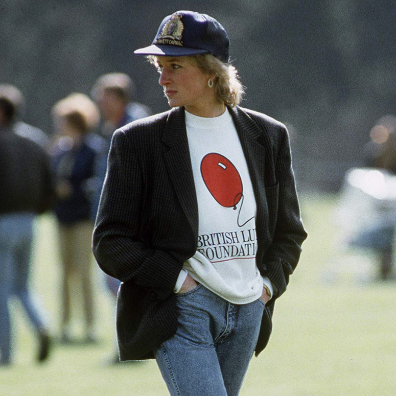 Diana, Princess Of Wales At Guards Polo Club. The Princess Is Casually Dressed In A Sweatshirt With The British Lung Foundation Logo On The Front, Jeans, Boots And A Baseball Cap.