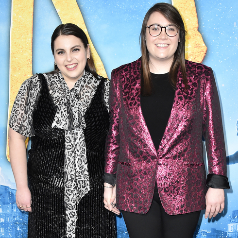 Beanie Feldstein poses with partner while holding hands