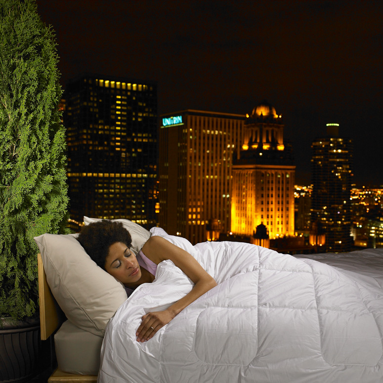 Woman sleeping in front of a skyline