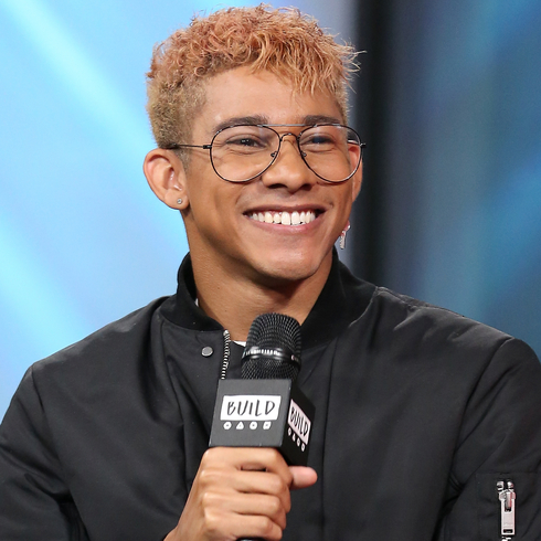Keiynan Lonsdale smiles while holding a mic at Build