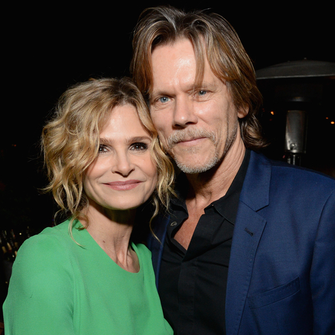 Kevin Bacon and Kyra Sedgwick pose for camera at an event