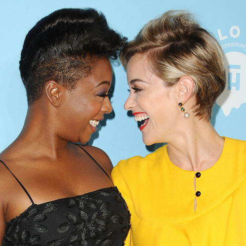 Samira Wiley and Lauren Morelli smile face-to-face