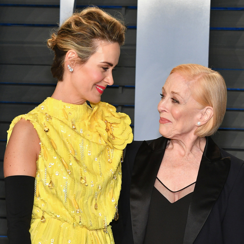 Sarah Paulson and Holland Taylor look at each other while smiling at the 2018 Vanity Fair Oscar party
