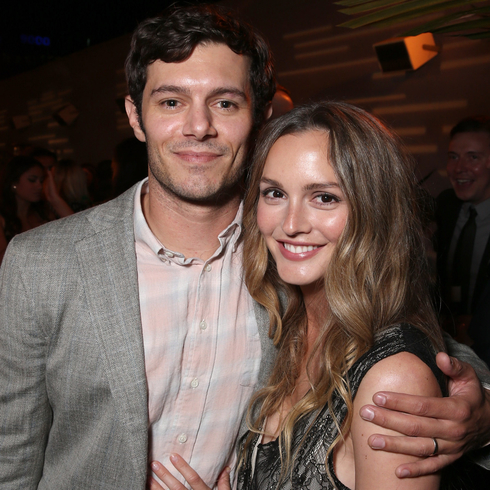 Adam Brody and Leighton Meester pose together an at event