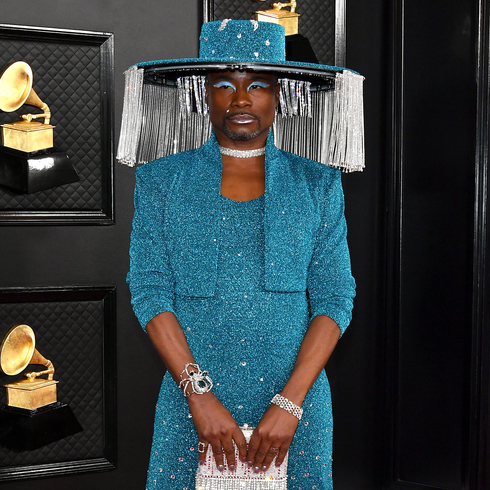 Billy Porter wears an eccentric blue suit and poses for the camera at the Grammy Awards