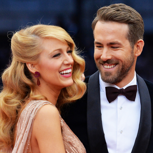 Rya Reynolds smiles happily while looking at wife Blake Lively