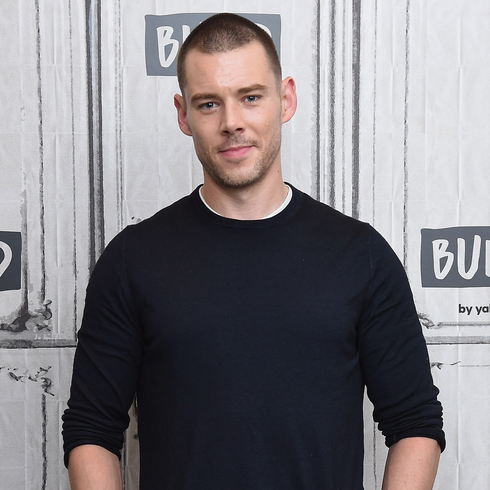 Brian J. Smith posing the camera with a slight smile