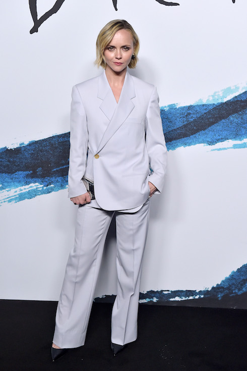 Christina Ricci wears a suit to the Dior fashion show in Paris in 2019